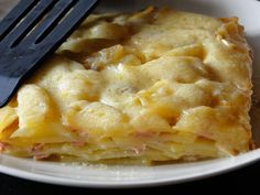 Potato Lasagna..peeled potatoes- chopped ham - heavy cream - milk - grated cheese - Oh such comfort food!