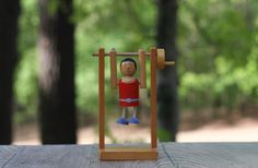 A personal favorite from my Etsy shop https://www.etsy.com/listing/290283161/vintage-wooden-gymnast-acrobat-toy