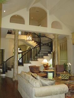 Centralized family room with spiral staircase, view 1