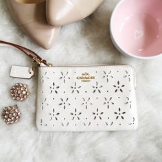 STYLE STAPLES HPx2Coach Laser Cut Corner Zip It's like Spring in a bag. This cutie would best be used in a larger bag, or if you're super efficient (or without a phone) could be carried on its own. The inside is even light pink!  Coach Bags Clutches & Wristlets