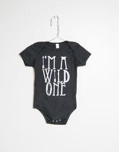 "Slyfox Threads ""I'm a Wild One"" Onesie.  An ultra-soft, short sleeve Onesie constructed in comfortable Sheer Jersey featuring an open neckline.  Sheer Jersey (100% Combed Cotton) construction Durable rib neckband Not intended for sleepwear Unisex  Available In Sizes: 3-6 Mo., 6-12 Mo., 12-18 Mo., 18-24 Mo."