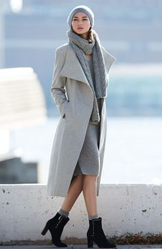 Staying chic and stylish even on chilly days with a sweater dress, cozy scarf and this classic wool wrap coat.