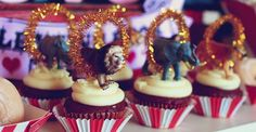 Circus Theme - I looove the gold pipecleaneers as circus rings with the animals through them. Another perfect theme for a boys 1st bday!