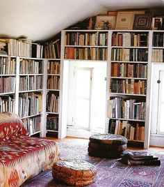 I love the combination of distressed white, patterned tapestries and rugs and all those dusty books. A beautiful room to fall asleep reading in.