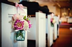 Mason Jars holding flowers at the end of the pew! Oh can I get married all over again!!
