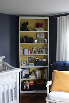 I love painting the inside of a bookshelf.. adds color and pulls a whole room together