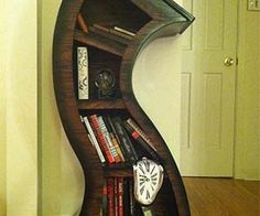 Make your home look a little more seasick with the curvy bookshelf, the bookshelf that makes your living room into a veritable Salvador Dali painting. These bookshelves are handcrafted of hard wood, and will hold your books up straight while giving your eyes a treat. Buy It $525.00 via Etsy.com