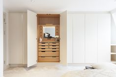 Built in wardrobes by @DualDesign handless doors, with one section with dressing table area.