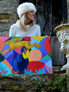 American Heraldic Painter and Professional Fine Artist Candice Jamieson and the original painting, 'In the Company of Hares' (NA). This painting was a collaboration created by The Jamieson Family.