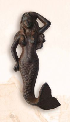 """Vertical Mermaid Clothes Hook. Handy as can be onboard the boat, in the shop: anywhere indoors, or out. We call this one the """"Happy Crab"""". Cast iron antique dark brownish finish. Nautical by nature. Vintage Rustic Cast Iron Hook has hardware installed on back to mount to wall. Measurements: 5.5"""" tall x 3""""wideand her tail acts as the hook which is 1"""" out from wall. Weight: 8 oz. Coastal or Beach House Wall Hooks: their stylish…"""