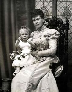 Volume 1: Page 24. Picture 8. British Royalty. 1896. Duchess of York (originally Mary of Teck) who later became Queen Mary (regined 1910-1936) by marriage to King George V. Pictured with her second son Prince Albert (later King George VI).
