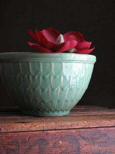 Vintage McCoy-fishscale bowl. This one is part of a nesting set and each is a different color (pink, yellow, cream, and green-different from the mint, shown). I really want a set of these.
