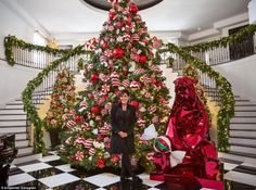 Can you keep up? From momager Kris Jenner's majestic 22ft candy-covered creation (above) to Kim's light fantastic pine, the OTT clan are going all out to shine in the most extravagant fashion this Christmas