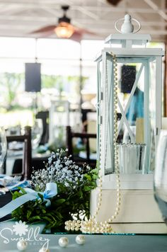 Light blue and pearls makes for a timeless look.    Photo: Swadley Studios Flowers: Flowers Unlimited Designs and Events.   Venue: Historic McFarland House