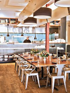 The Food Market's open kitchen overlooking a sleek dining room. Our 50 Best Restaurants | Baltimore magazine Photo by Scott Suchman