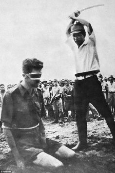 Japanese officer Yasuno Chikao frozen forever in the act of executing Australian commando Leonard Siffleet  on Aitape Beach,  24 October 1943. the photo was found by American troops on the body of a dead Japanese soldier in April 1944 and was published in an Australian magazine and in Life. magazine in the US