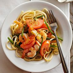 Lemon flavor brings the zest and fresh flavor to this deliciously easy pasta dish. Click through for more weeknight dinners: https://www.bhg.com/recipes/quick-easy/dinners-30-minutes-less/fast-fix-weeknight-suppers/?socsrc=bhgpin012014shrimpandtomatopiccatapage=12