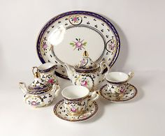 Porcelain Miniature Tea Set in Blue & White w Florals, Tray, Teapot w Lid, Sugar w Lid, Two Cups w Two Saucers.