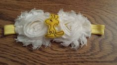 Check out this item in my Etsy shop https://www.etsy.com/listing/247939016/peanuts-woodstock-shabby-flower-headband