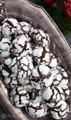 Chocolate crinkle cookies with chocolate cookie dough rolled in powdered sugar and baked into a festive black and white cookie. Perfect Christmas cookie! ~ SimplyRecipes.com