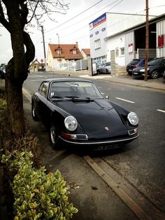 This is my dream. To own a black 912 to sit next to my modern Boxster in the garage.