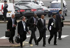 Obama walks with aide Reggie Love and Mike Froman, Deputy National Security Advisor for International Economic Affairs on his way to a dinner at the G8 summit, May 26, 2011.