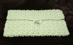 Crochet light green tablet sleeve/clutch  8.5 x 5.5 by RoxieandBen.  For sale on Etsy, $28. See our Holiday sale on Etsy - 10% off now through Monday, December 1, 2014.