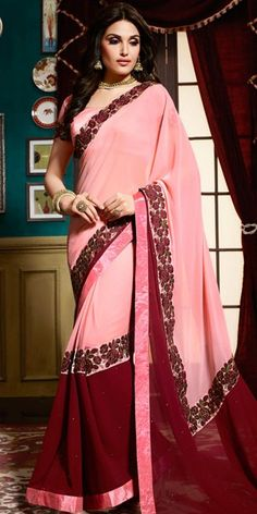 Fancy Pallu Saree in Peach And Maroon Color.