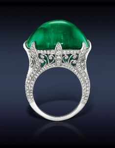 Emerald Cocktail Ring Featuring: A Breathtaking, Gubelin & AGL Certified 42.95 Ct Colombian Emerald (Center Stone) Surrounded by 1.31 Ct White Diamonds, Mounted in Platinum.