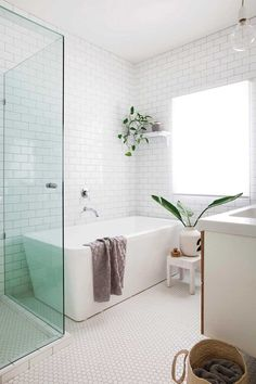 Home Renovation Bathroom Timeless bathroom design with white tiles, huge window and squared off free standing tub. 8 bathrooms that are big on style Bathroom Layout, Bathroom Interior Design, Bathroom Ideas, Tile Layout, Bathroom Colors, Bath Ideas, Bathroom Designs, Small Bathroom Plans, Restroom Ideas