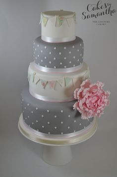 Victoria's Grey and tiny polka dots and fabric like bunting Wedding Cake.