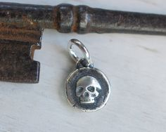 tiny skull wax seal necklace charm... seriously by suegrayjewelry, $18.00