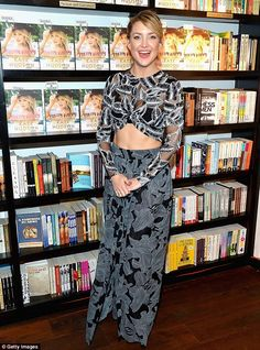 In beautiful shape: Kate Hudson showed off her fabulous figure in a sheer black and white ensemble as she promoted her lifestyle book, Pretty Happy: Healthy Ways To Love Your Body, in Bal Harbour, Florida on Friday