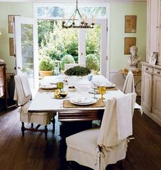 Notice the Details                           Formal dining room chairs have a more relaxed feel with neutral linen slipcovers. The half skirt still reveals each chair's                             turned legs, while simple ties add a custom dressmaker detail.