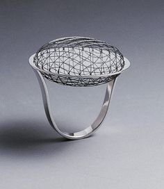 Cool little orbital ring. Orbital ring by Sergey Jivetin, born in Uzbekistan; made of nitinol and gold. Contemporary Jewellery, Modern Jewelry, Luxury Jewelry, Metal Jewelry, Vintage Jewelry, Space Jewelry, Jewelry Art, Jewelry Design, Jewelry Rings