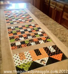 THE QUILTED PINEAPPLE: Haunted Little Houses Runner http://www.thequiltedpineapple.com/2012/09/haunted-little-houses-runner.html