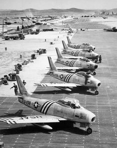 """Five North American F-86A Sabre fighters of the 4th Fighter Interceptor Wing on the flight line at Suwon, South Korea, in June 1951."""