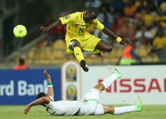 Togo's Jonathan Ayite, top, avoids a tackle from Algeria's Rafik Halliche during their African Cup of Nations Group D soccer match at the Ro...