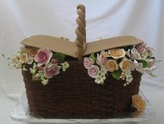 This cake, for a bridal shower, is flavored white with chocolate mousse filling covered with hand made chocolate buttercream icing. The flowers were gumpaste. Flower Basket Cake, Cake Basket, Beautiful Wedding Cakes, Beautiful Cakes, Amazing Cakes, Fondant Cakes, Cupcake Cakes, Cupcakes, Realistic Cakes
