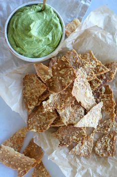 Low carb parmesan cheese crackers with avocado basil pesto dip.