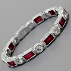 Diamond and ruby band ... Luca's birthstone. Would love this someday. <3