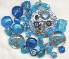 25 Pcs Bright Blue Bead Mix Murano Style Glass Large Blue Pendant Metal Paw Print Glass Heart   https://www.etsy.com/ca/listing/546267943/25-pcs-bright-blue-bead-mix-assorted?ref=shop_home_active_7