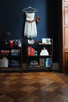 "Small (6.5' x 9'), NAVY Blue Bedroom! Accented with natural dark wood. Decorating with white and using clear storage makes this bedroom ""cozy at night while toning down the bright morning sunlight."" I like it. -- from apartmenttherapy.com"