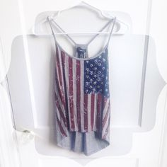 American Flag Rue 21 Tank This is such a cute top! Only worn once, maybe twice. I still love it but just think it could find a better home. Slightly cropped in the front -- looks great with high waisted shorts. :)   ⭐️BUNDLE THIS ITEM TO GET IT FOR LESS⭐️ Rue 21 Tops Tank Tops