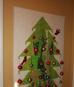 In the hallway  between my laundry room and kitchen pantry, I've put a simple quilted  tree. I made it in wide horizontal strips using scra...