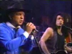 Garth Brooks & Kiss   Hard luck woman  This was cool!!  He was singing with KISS.  :)