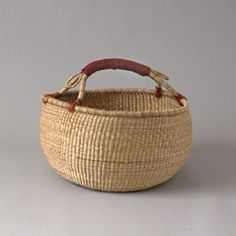 I love baskets.  I used to really hate baskets and really loathe anything that resembled wicker.  This stems from a summer working at Pier 1.  But now, I love 'em.  So handy!