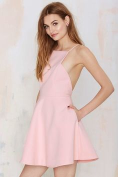 8bcba4e285 Angled view of girl in pink cutaway neckline skater dress