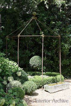 GARDEN STRUCTURES: An iron gazebo from Anthropologie sits at the end of the gravel driveway. Could I make this from copper plumbing pipe like my trellis? Designed by Jill Brinson in Atlanta. Metal Pergola, Diy Pergola, Pergola Ideas, Iron Pergola, Pergola Cover, Arbor Ideas, Curved Pergola, Cheap Pergola, Wooden Pergola