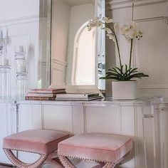 Pink Velvet Stools Under Lucite Console Table